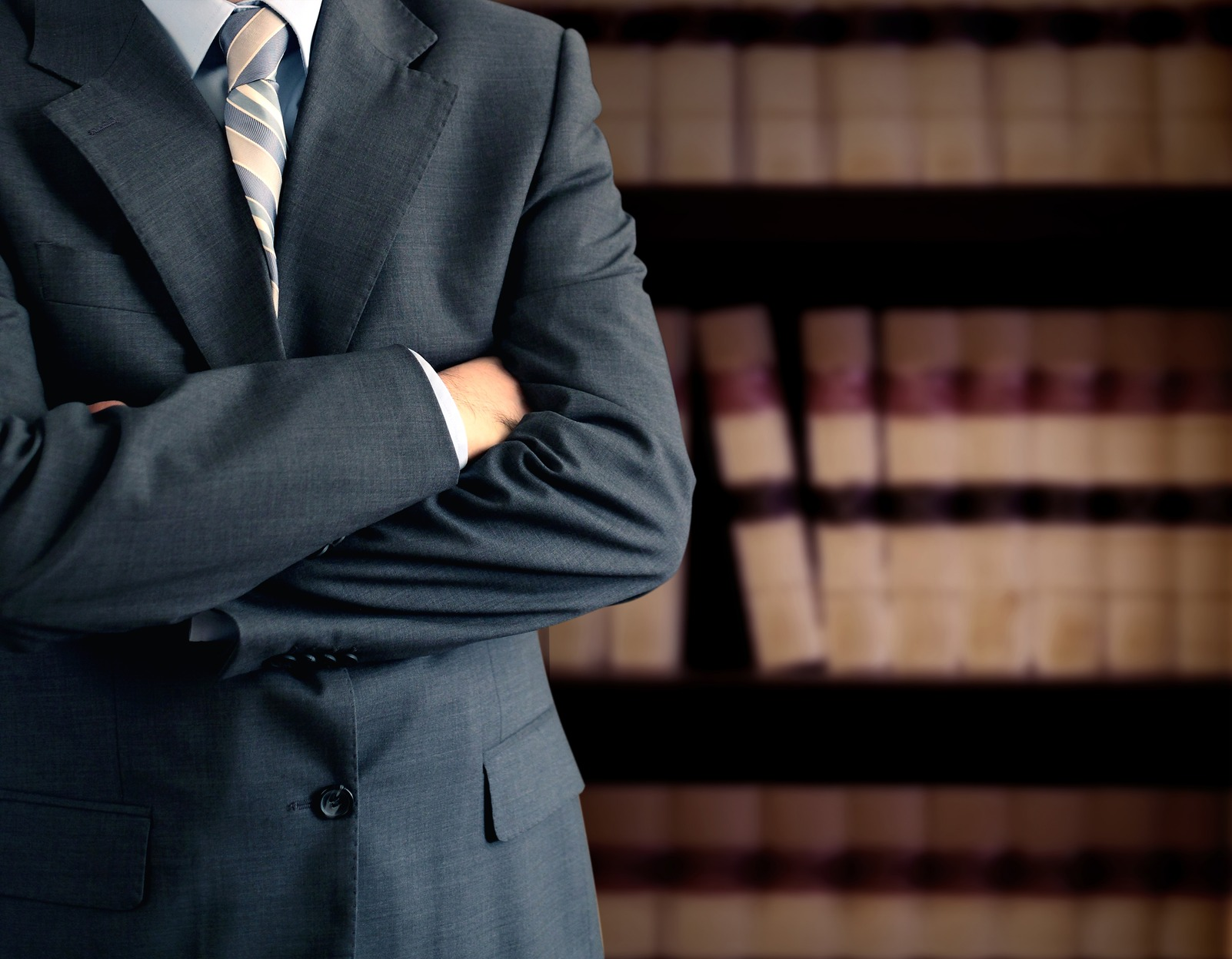 Businessman in front of bookcase